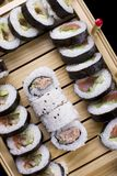 Sushi set on a board. Set of sushi on a wooden board Royalty Free Stock Images