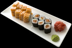 Sushi set California with wasabi on white plate isolated Stock Images