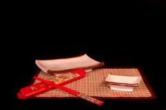 Sushi set and chopsticks. On black background royalty free stock photography