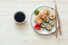 Sushi set and chopstiks on white wooden background Stock Photo