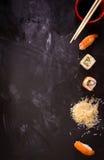 Sushi set on dark background. Minimalism Royalty Free Stock Image