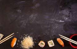 Sushi set on dark background. Minimalism Royalty Free Stock Photo