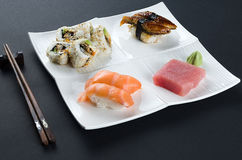 Sushi set on dark background Stock Images