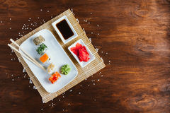 Sushi set on a dark wooden background. Sushi set on a dark wood background with wasabi, ginger and soy sauce Stock Images