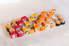 Sushi set of different rolls idea, unusual, creative top on a white background Stock Photos
