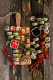 Sushi set food photo. Rolls served on brown wooden and slate plate. Close up and top view of sushi.  stock photos