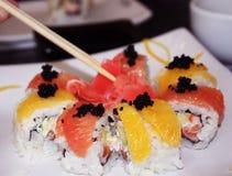 Sushi set. With fresh orange and grapefruit Royalty Free Stock Photos