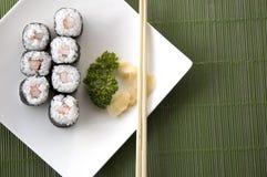 Sushi set on green background Royalty Free Stock Image