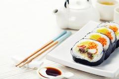 Sushi set, green tea and sakura branch Stock Images