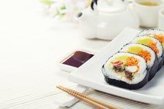 Sushi set, green tea and sakura branch Royalty Free Stock Image