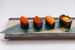 Sushi Set Include Tobiko, Ikura, Sea Urchin and Ikura, Urchin and Quail Egg Yolk Served on Leaf on Stone Plate Royalty Free Stock Image