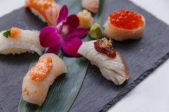 Sushi Set Include Torched Salmon, Engawa, Hotate, Hamachi, Tai and Ikura with Hirame Served with Wasabi and Prickled Ginger. Stock Photo