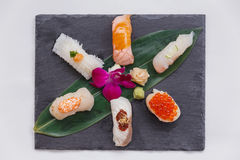 Sushi Set Include Torched Salmon, Engawa, Hotate, Hamachi, Tai and Ikura with Hirame Served with Wasabi and Prickled Ginger. Stock Image