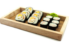 Sushi set in a kitchen board Royalty Free Stock Image