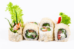 Sushi set with leawes salad and paprika Stock Image