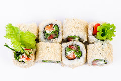 Sushi set with leawes salad and paprika top view Stock Image