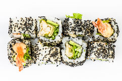 Sushi set with leawes salad and tiger shrimps top Royalty Free Stock Photography