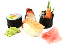 Sushi set with Nigiri and Maki sushi. Served on a white plate Royalty Free Stock Photography