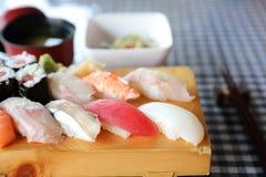 Sushi Set nigiri and sushi maki with tea , Japanese food. Sushi Set nigiri and sushi maki with tea on wooden plate , Japanese food royalty free stock image