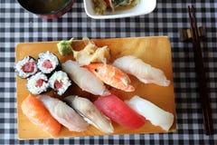 Sushi Set nigiri and sushi maki , Japanese food. Sushi Set nigiri and sushi maki on wooden plate , Japanese food stock images