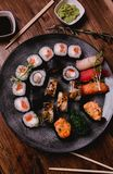 Sushi set nigiri and rolls served on brown wooden table background. Top view food photography Royalty Free Stock Image