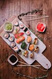 Sushi set nigiri and rolls served on brown wooden table on marbel stone plate. Top view food photography Stock Photos