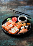 Sushi set nigiri and rolls served in round plate stock photos
