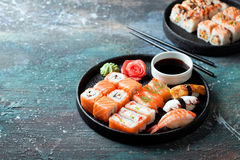 Sushi set nigiri and rolls served in round plate stock photography