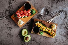 Sushi Set nigiri and sushi rolls with tea served on gray stone slate royalty free stock photos