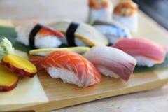 Sushi Set nigiri and sushi rolls on wooden table royalty free stock image