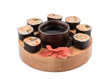 Sushi Set nigiri and sushi rolls on wooden serving board with soy sauce stock image