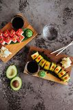 Sushi Set nigiri and sushi rolls with tea served on gray stone slate royalty free stock photography
