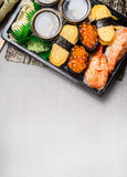 Sushi set with nigiri,  tamago egg , ama ebi raw prawn  and uni ikura on gray stone background, top view Royalty Free Stock Image