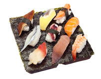 Sushi Set of Nine. 9 pieces of sushi/sashimi on a piece of seaweed Stock Image