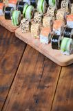 Sushi set of a number of rolls is located on a wooden cutting board on a table in the kitchen of a sushi bar. A traditional dish. Of oriental cuisine Royalty Free Stock Image
