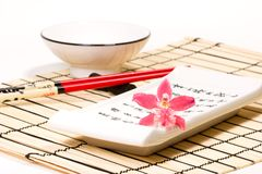 Sushi set and orchid flower on Royalty Free Stock Image