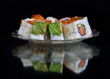 Sushi set at plate on black