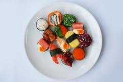 Sushi set on plate. Japanese food, sushi set on plate isolated on white background Royalty Free Stock Image