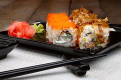 Sushi set on plate with wasabi and marinated ginger Royalty Free Stock Photo