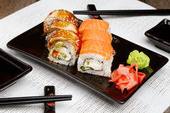 Sushi set on plate with wasabi and marinated ginger Royalty Free Stock Photos