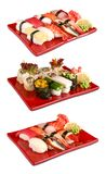 Sushi set in red plates stock photos