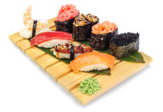 Sushi set of rolls on bamboo board Royalty Free Stock Image