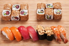 Sushi  set with rolls and  nigiri  served on a wooden board, sushi with tuna, salmon and tiger shrimp Stock Photos