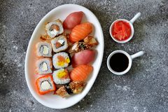 Sushi set with salmon, soft cheese, tuna, smoked eel. Healthy food. Top view. Food stock photography