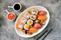 Sushi set with salmon, soft cheese, tuna, smoked eel. Healthy food. Top view. Food royalty free stock photos