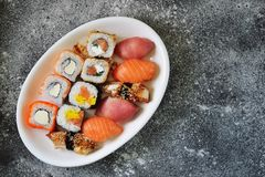 Sushi set with salmon, soft cheese, tuna, smoked eel. Healthy food. Top view. Food royalty free stock image