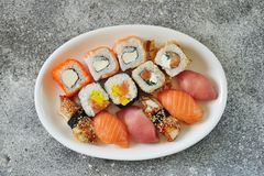 Sushi set with salmon, soft cheese, tuna, smoked eel. Healthy food. Top view. Food royalty free stock photography