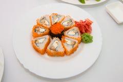Sushi Set sashimi and sushi rolls served on stone slate. Sushi stock image
