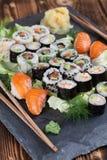 Sushi set on a slate stone. Sushi set on a slate board. Maki, uramaki and nigiri sushi royalty free stock photo