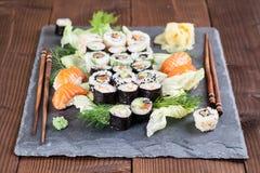Sushi set on a slate stone. Sushi set on a slate board. Maki, uramaki and nigiri sushi royalty free stock photography